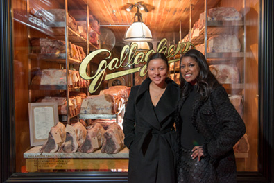 Guests standing in front of the Gallaghers Steakhouse meat locker